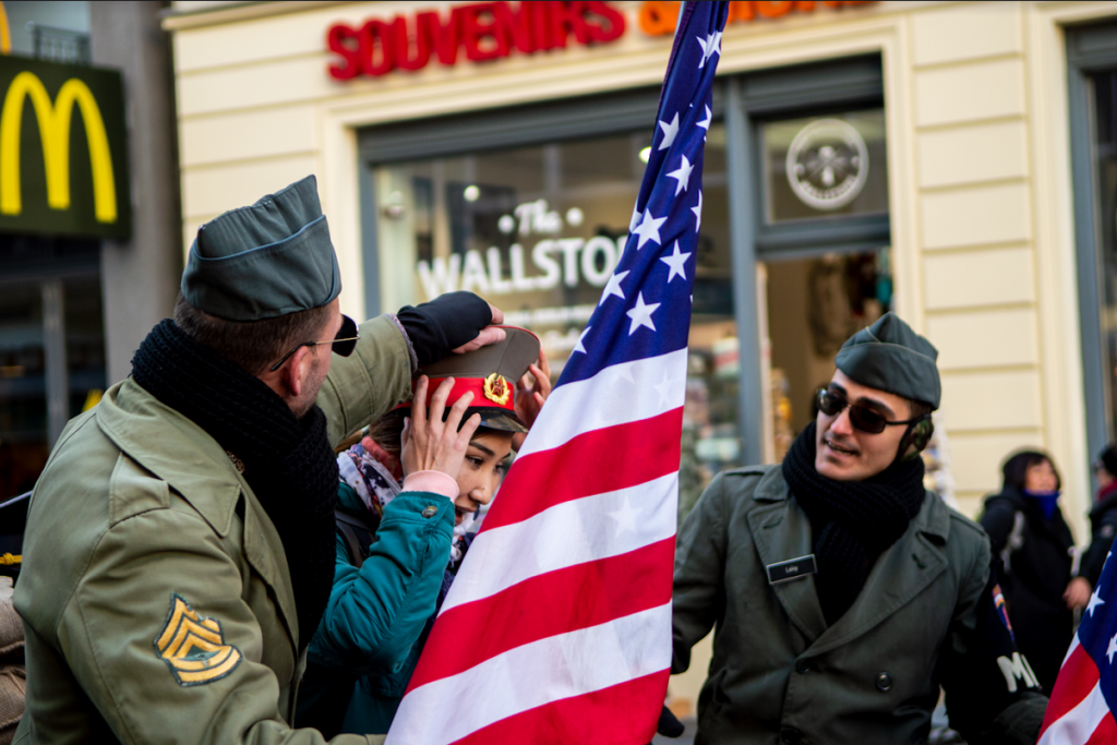 Berlin Checkpoint Charlie Soldiers Guards Woman Hat American Flag
