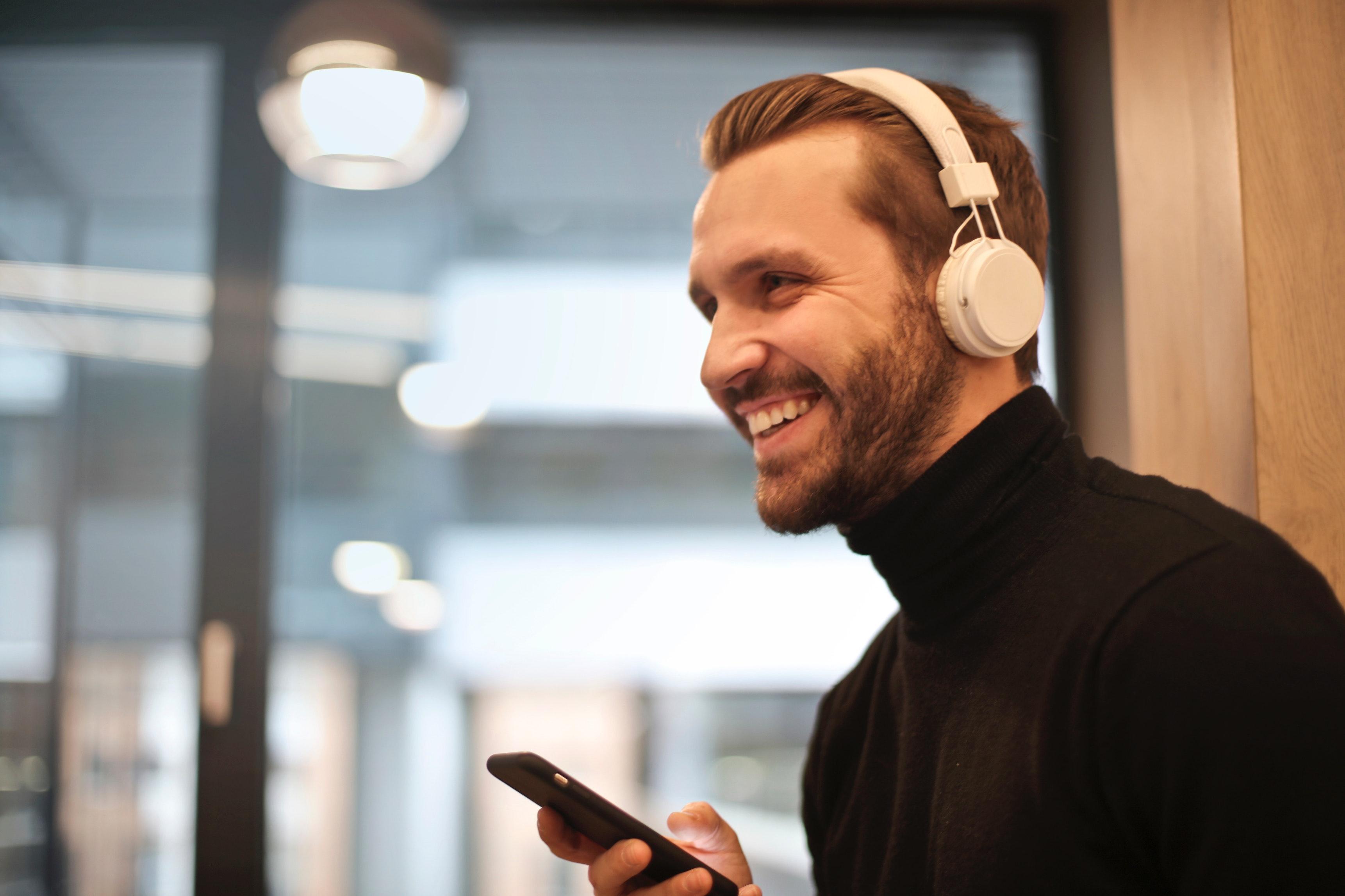 headphones man podcasts happy