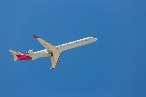 plane blue sky visiting clients